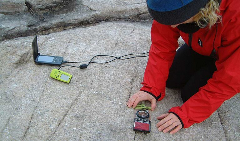 Recording fracture measurements using an early digital field mapping system in 2003, with hand-held GPS connected to a PDA.