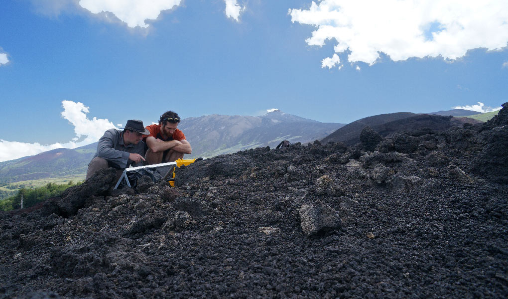 Checking one of our autonomous GNSS units on Mt. Etna